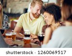multicultural friends drinking... | Shutterstock . vector #1260069517