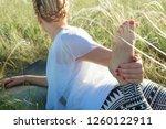 girl doing yoga on a beautiful...   Shutterstock . vector #1260122911