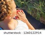girl meditates sitting on a...   Shutterstock . vector #1260122914