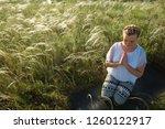girl meditates sitting on a...   Shutterstock . vector #1260122917