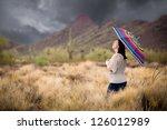 Woman Walking In The Desert...