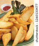 closed up fried golden potato... | Shutterstock . vector #1260133477