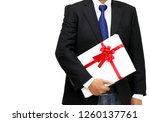 businessman holding gift box... | Shutterstock . vector #1260137761