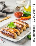 grilled sausages with sauce... | Shutterstock . vector #1260145441