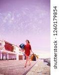 young beautiful lady walking... | Shutterstock . vector #1260179854