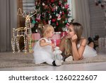 mom and daughter are sitting... | Shutterstock . vector #1260222607