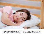 beautiful asian woman sleeps in ... | Shutterstock . vector #1260250114