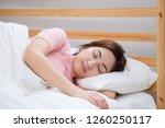beautiful asian woman sleeps in ... | Shutterstock . vector #1260250117