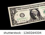 one us dollar bill on black... | Shutterstock . vector #1260264334