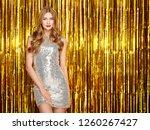 beautiful woman celebrating new ... | Shutterstock . vector #1260267427