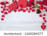 roses and red hearts on a... | Shutterstock . vector #1260284377