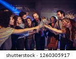 shot of young people toast in... | Shutterstock . vector #1260305917