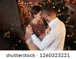 reflection of the christmas... | Shutterstock . vector #1260323221