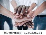 business team joining hands... | Shutterstock . vector #1260326281