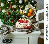 homemade pavlova cake with... | Shutterstock . vector #1260356371