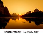the china guilin sunset raft | Shutterstock . vector #126037589
