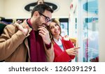 shopping time. young couple... | Shutterstock . vector #1260391291