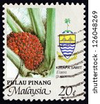 Small photo of MALAYSIA - CIRCA 1986: a stamp printed in Malaysia shows African Oil Palm, Elaeis Guineensis, Plant, circa 1986