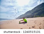 sportsman stretching on a... | Shutterstock . vector #1260515131