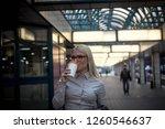 woman drinking coffee on... | Shutterstock . vector #1260546637