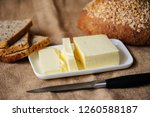 piece of butter with bread on a ... | Shutterstock . vector #1260588187
