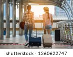 two tourist girl with drag bag... | Shutterstock . vector #1260622747