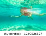 young woman snorkeling in... | Shutterstock . vector #1260626827