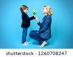 mother and her son are posing... | Shutterstock . vector #1260708247