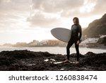 strong brunette guy standing in ... | Shutterstock . vector #1260838474