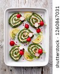 spinach roulade stuffed with... | Shutterstock . vector #1260867031