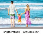 happy family playing on the sea ... | Shutterstock . vector #1260881254