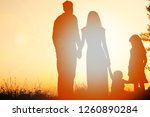 silhouette of a happy family on ... | Shutterstock . vector #1260890284