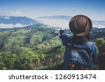 hiking  happy female tourist to ... | Shutterstock . vector #1260913474