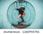 young asian active man jumping... | Shutterstock . vector #1260954781
