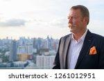 handsome senior businessman... | Shutterstock . vector #1261012951