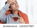 ailing woman wipes her forehead ... | Shutterstock . vector #1261017007