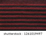 red and black striped knit...   Shutterstock . vector #1261019497