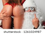 bad santa claus in snow flakes... | Shutterstock . vector #1261024987