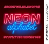 red neon tube alphabet font.... | Shutterstock .eps vector #1261039624