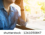 woman holding and using... | Shutterstock . vector #1261050847