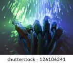 Network cables with fiber optical background - stock photo