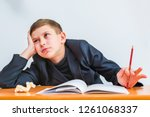 Small photo of inattentive student in the classroom. attention deficit disorder