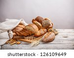 mix of bread on cutting board...   Shutterstock . vector #126109649