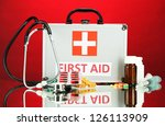 first aid box  on red background | Shutterstock . vector #126113909