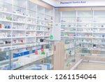 medicines arranged in shelves ...   Shutterstock . vector #1261154044
