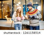 young happy couple dressed in... | Shutterstock . vector #1261158514