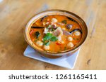 selective focus tom yum kung on ... | Shutterstock . vector #1261165411