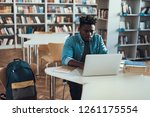 concentrated diligent student... | Shutterstock . vector #1261175554