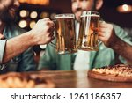 close up of male hands clinking ... | Shutterstock . vector #1261186357
