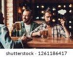 portrait of handsome bearded... | Shutterstock . vector #1261186417